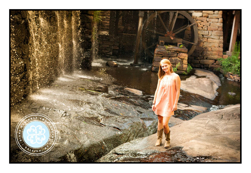 Senior girl in boots, dress and waterfall