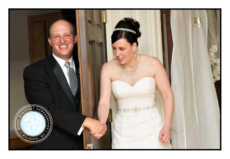Bride and Groom holding hands around door