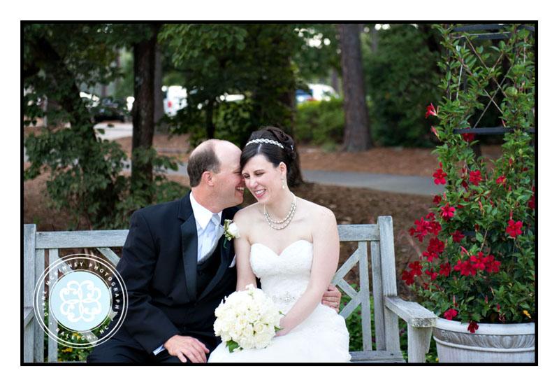 Bride and Groom telling secret