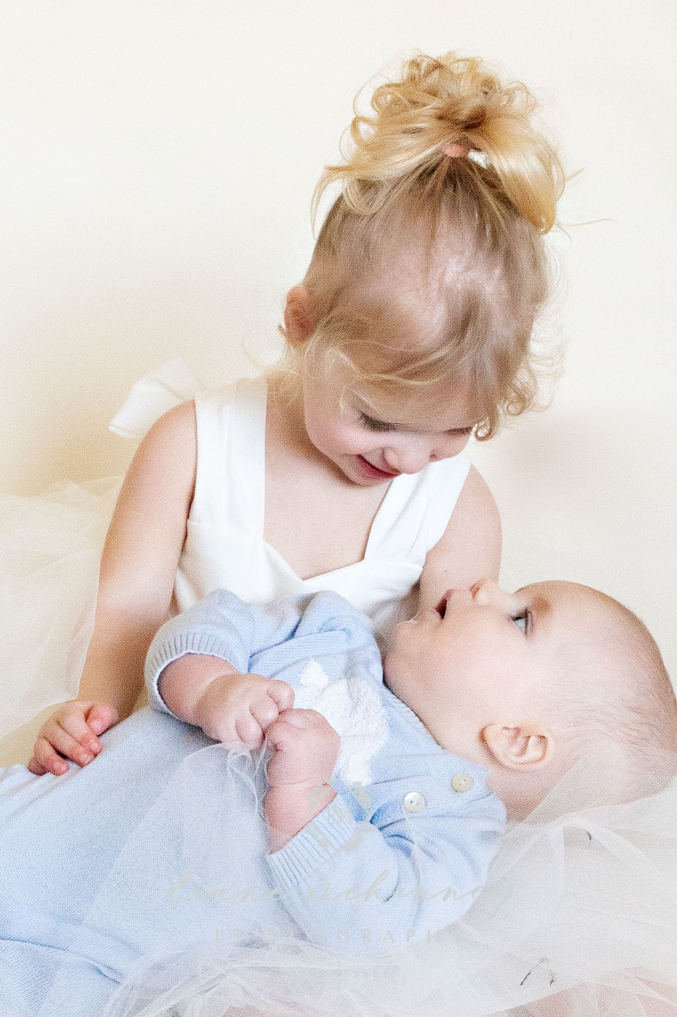 Sibling and baby photos